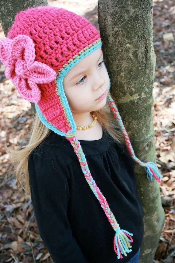 https://www.etsy.com/listing/87010019/crochet-hat-with-flower-and-earflaps?ref=shop_home_active_13
