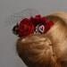 red flower head piece wedding hair