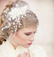 birdcage veil with vintage flower