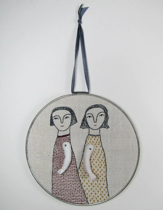 hand embroidery-two women in red and mustard