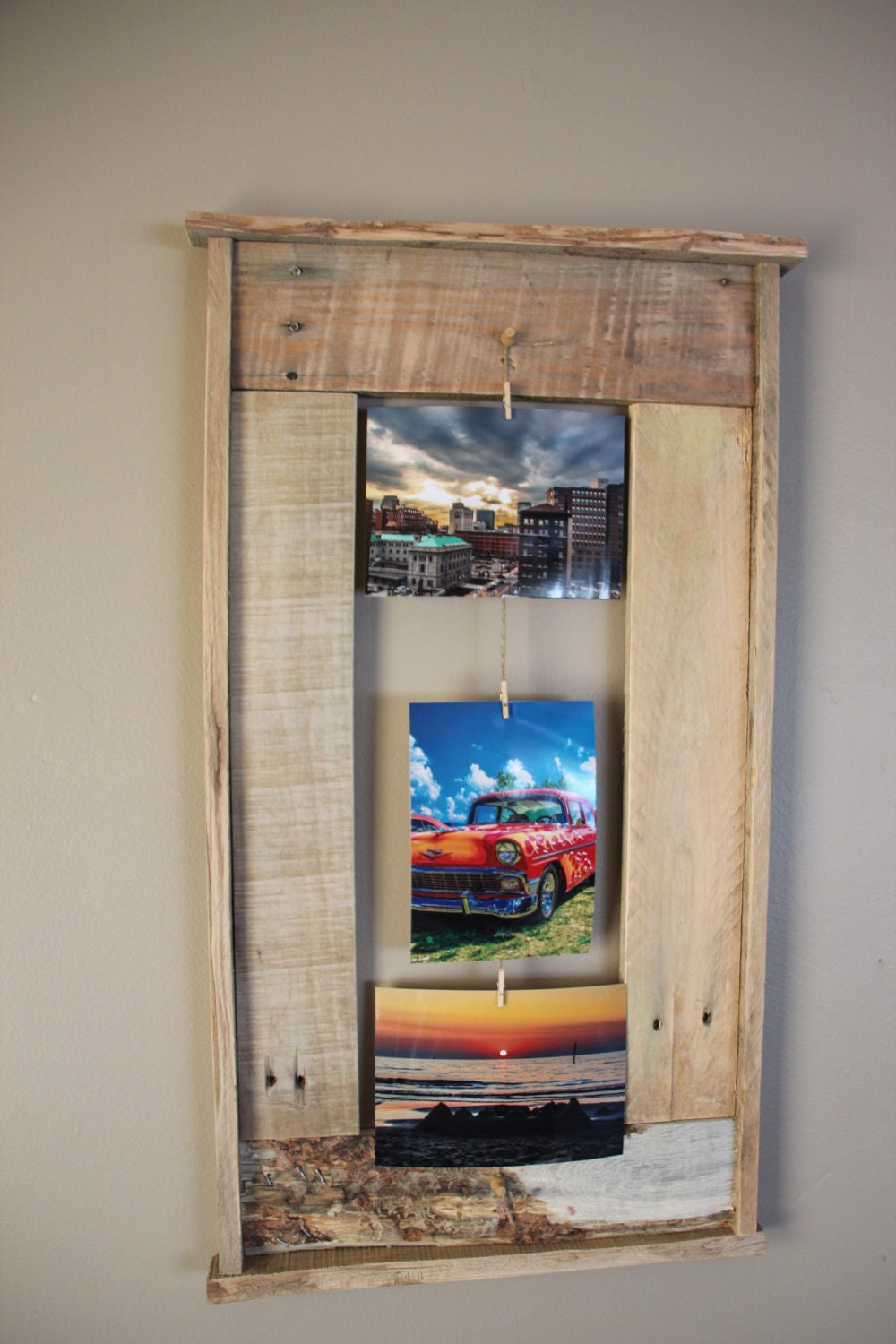 Wooden pallet frame picture frame that holds 3 by