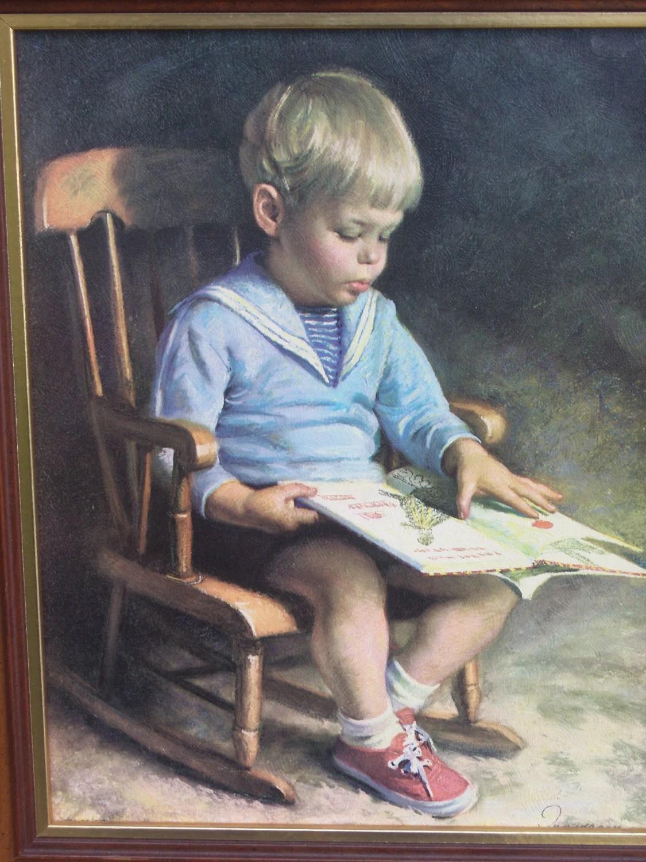 Little Boy Reading in Rocking Chair Framed Art