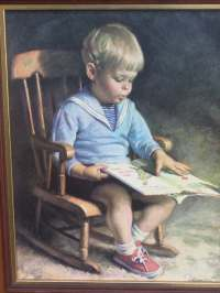 Little Boy Reading in Rocking Chair Framed Art