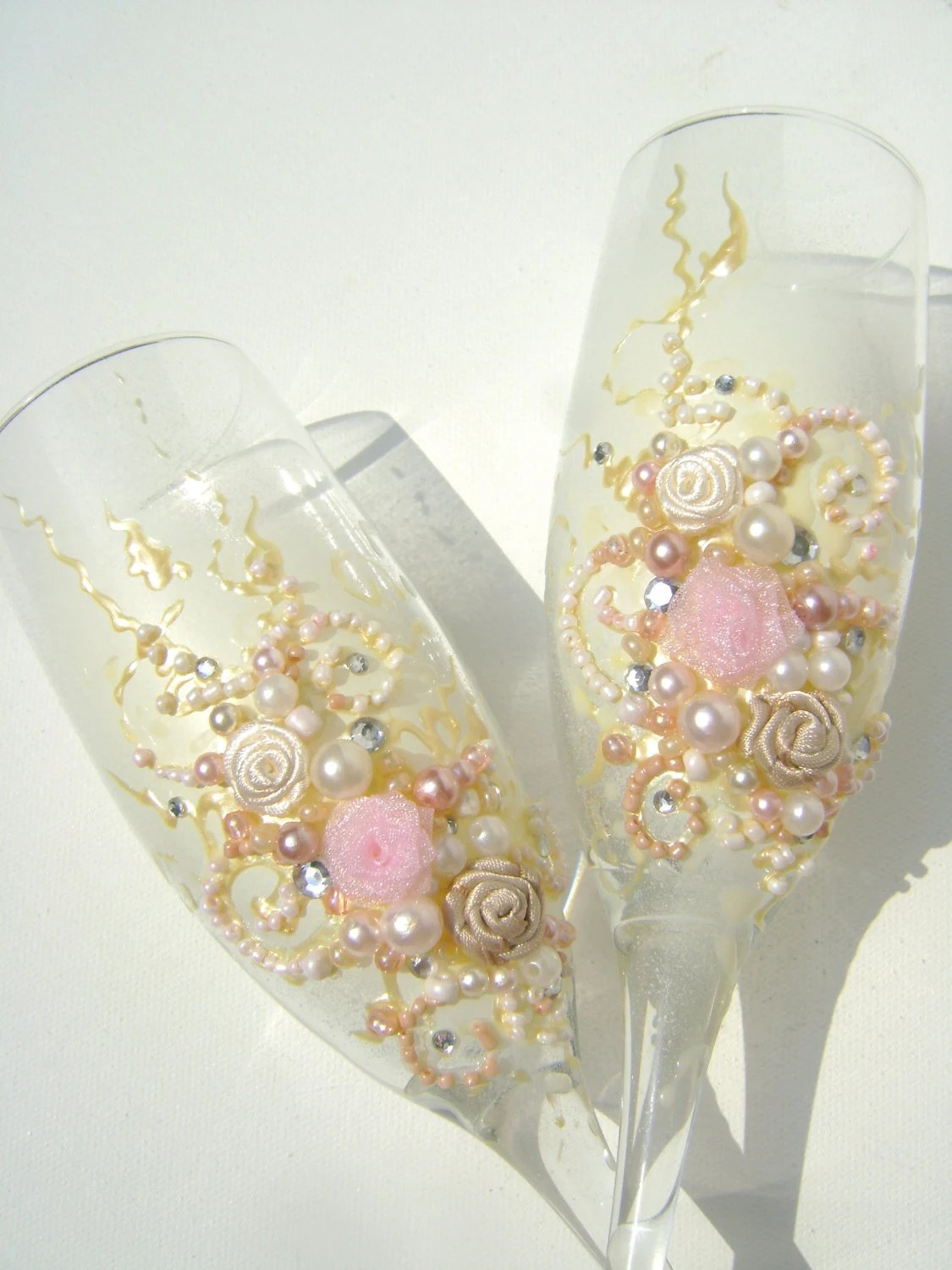 Beautiful wedding champagne glasses in light pink ivory and