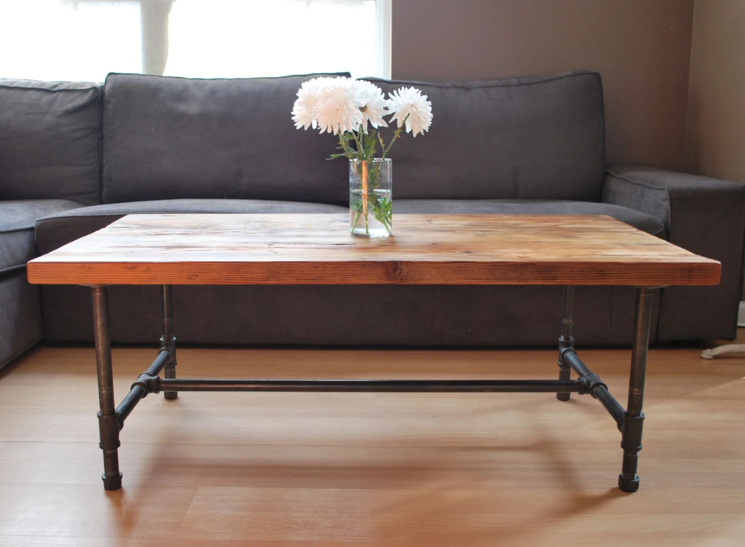 Items similar to Wood Coffee table with steel pipe legs