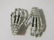 pair of skeleton hand hair clips