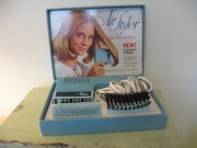 vintage 1970s hair dryer and brush