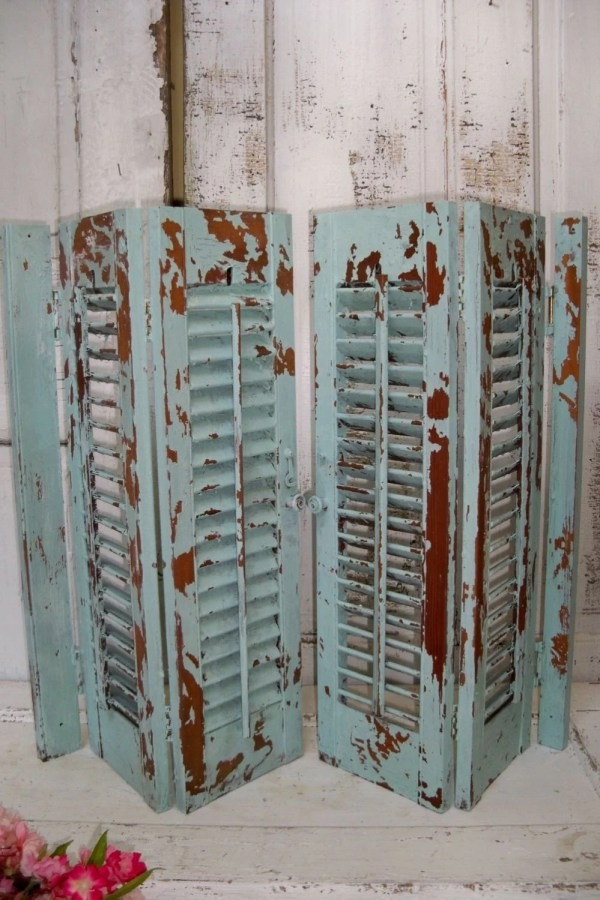 Wooden shutters sea glass blue green distressed recycled wall