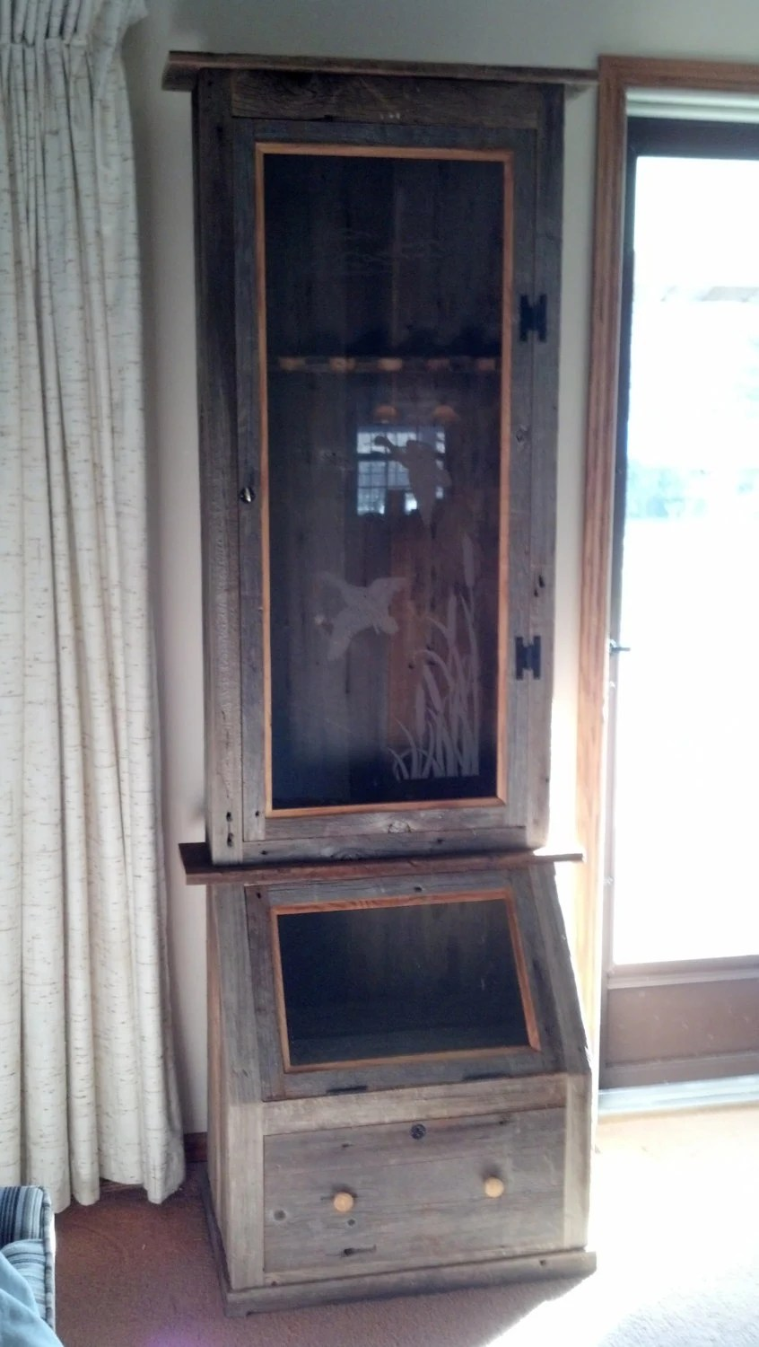 Six gun cabinet with display case and drawer