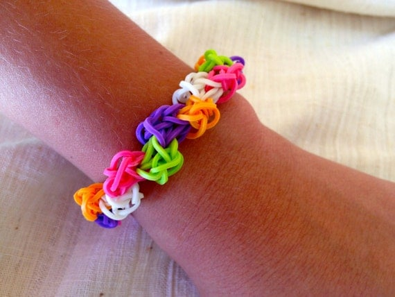 Rainbow Loom bracelet made from rubber bands in pink, orange, purple, neon green and glowing in the dark bands. stretchable.