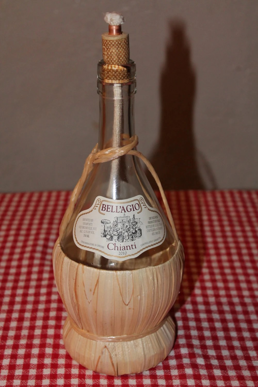 Oil lamp made from a Chianti wine bottle.