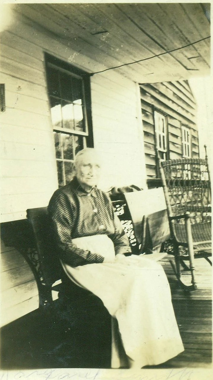 Old Farm Woman Sitting On Porch Wooden Bench Wicker Rocking