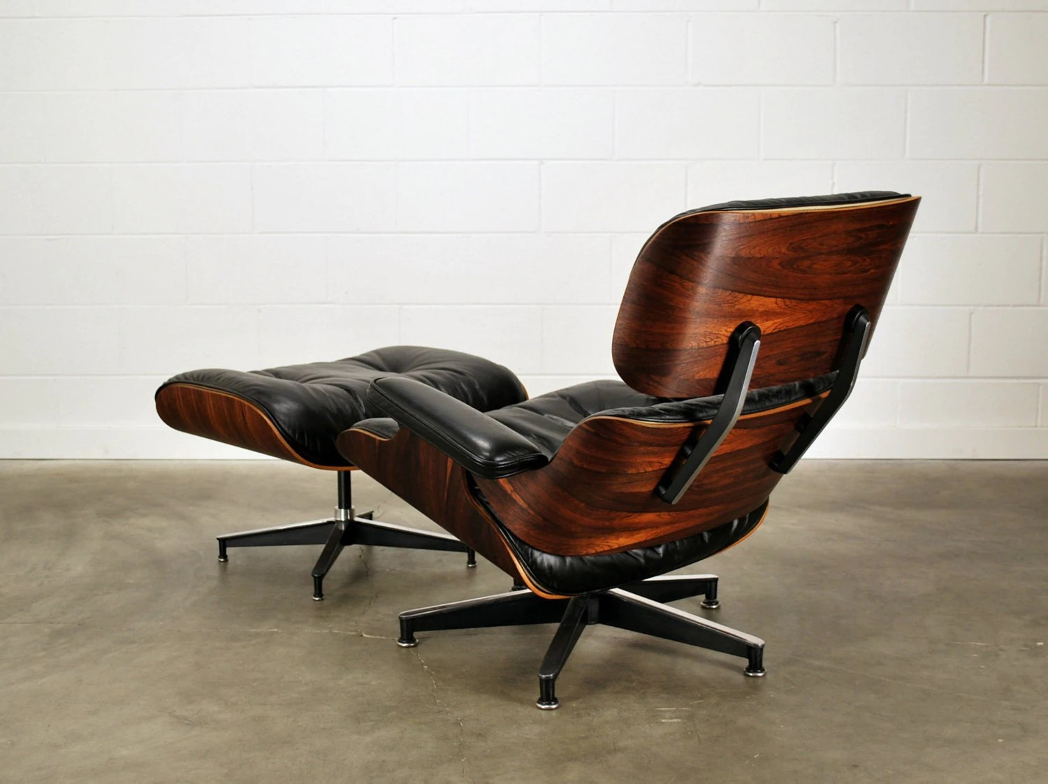 eames style lounge chair and ottoman rosewood black leather silver early herman