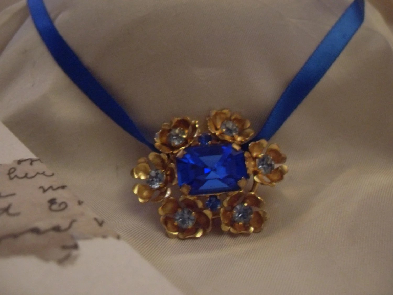 Recrafted Ribbon brooch necklace,goldtone,bluestone