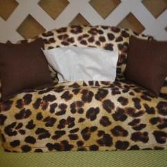 Leopard Print Sofa Appears Brown Leather Sectional With Chaise Tissue Box Cover In Shape Tan And
