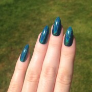 holographic teal stiletto nails