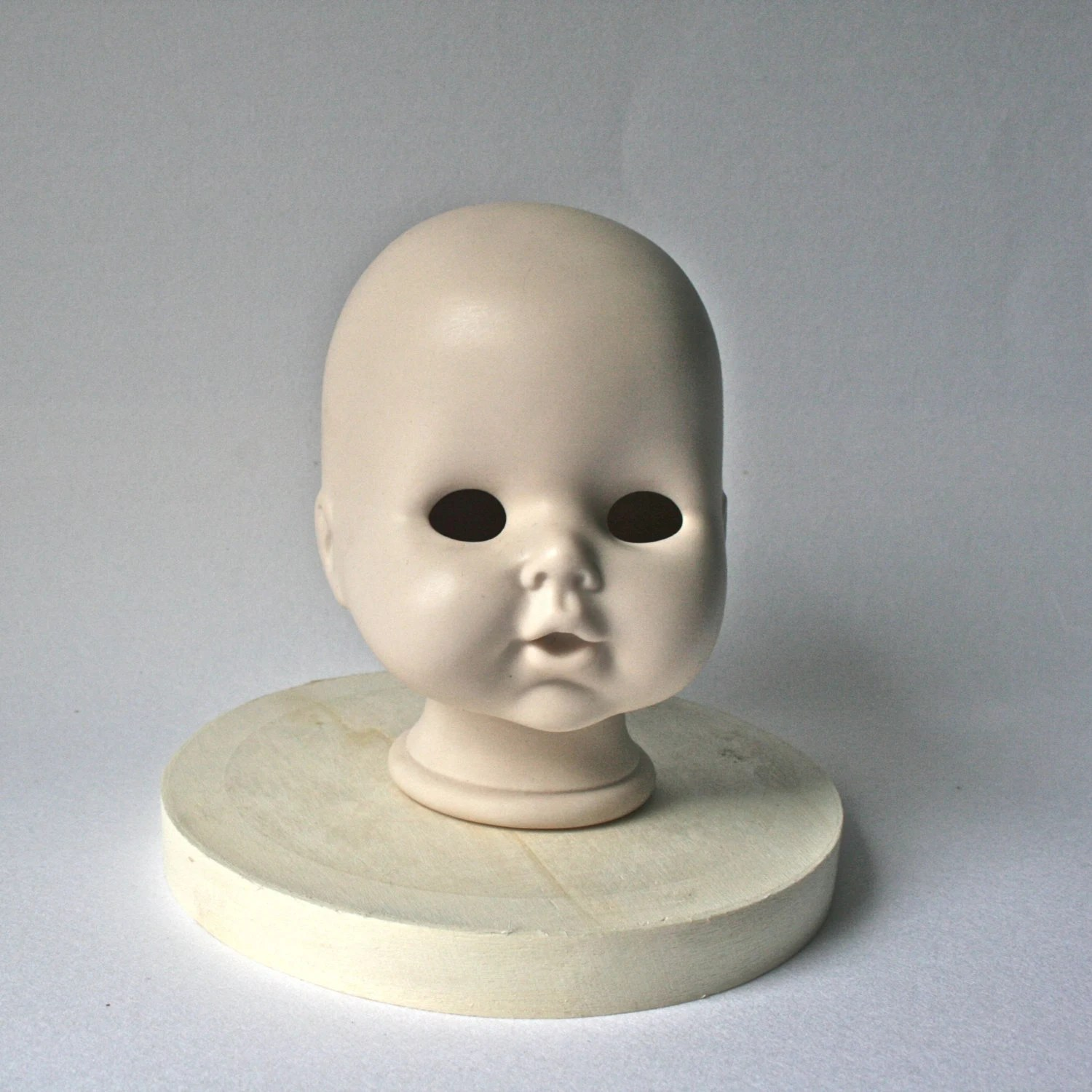 Vintage Porcelain Bald Doll Head with Sweet Expression for