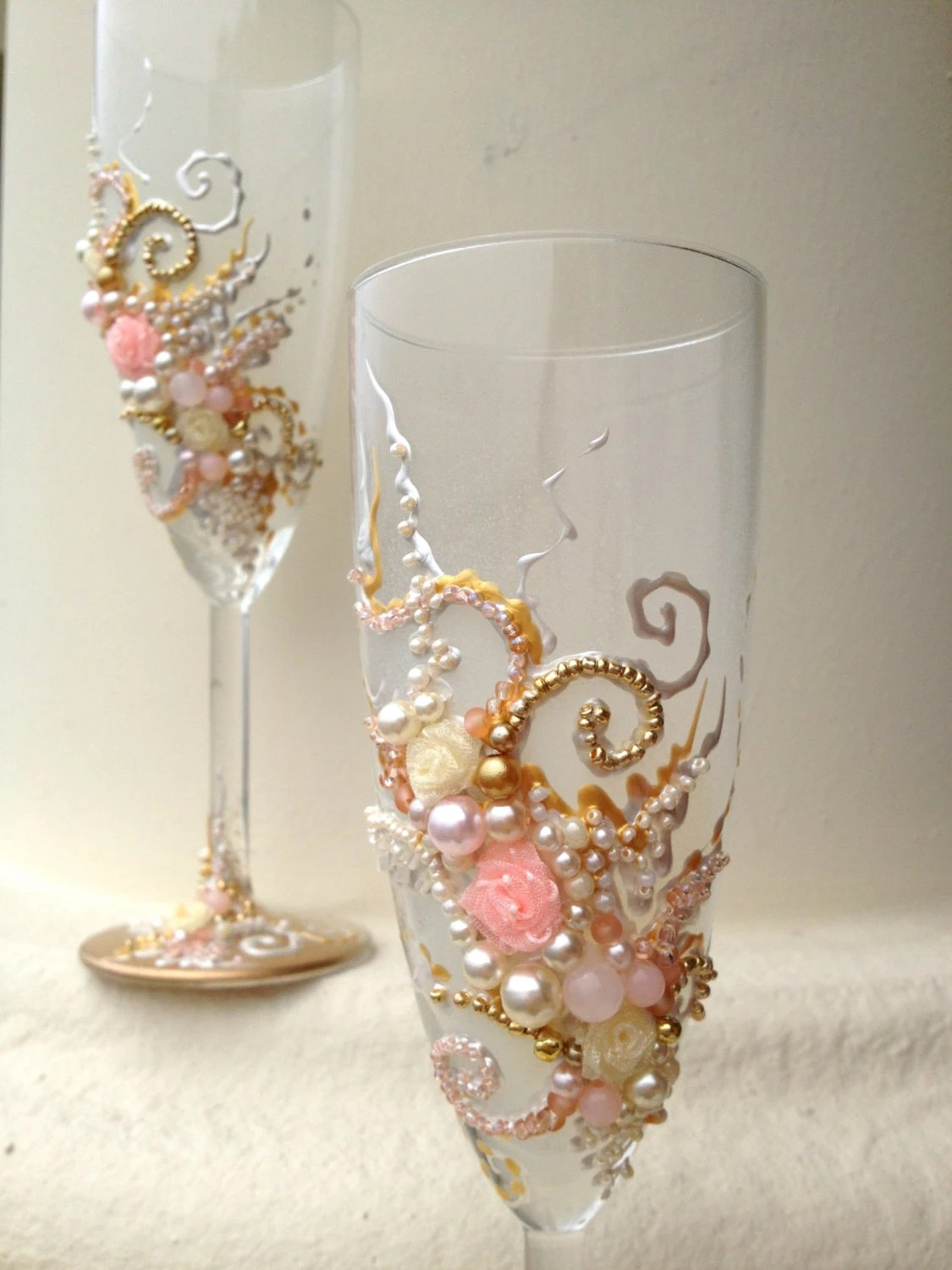 Beautiful wedding champagne glasses in blush pink gold and