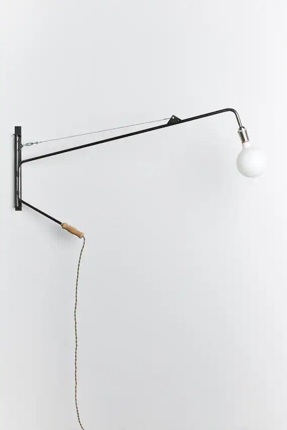 Potence swing arm lamp