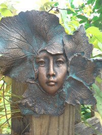 Garden art wall sculpture female face leaf copper Autumn