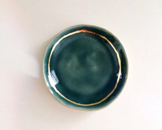 navy blue porcelain ring dish with golden rim