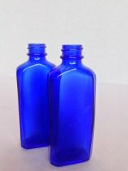 blue glass vintage clairol bottles