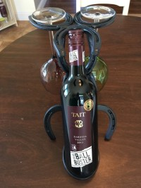 Horseshoe wine bottle holder and glass holders