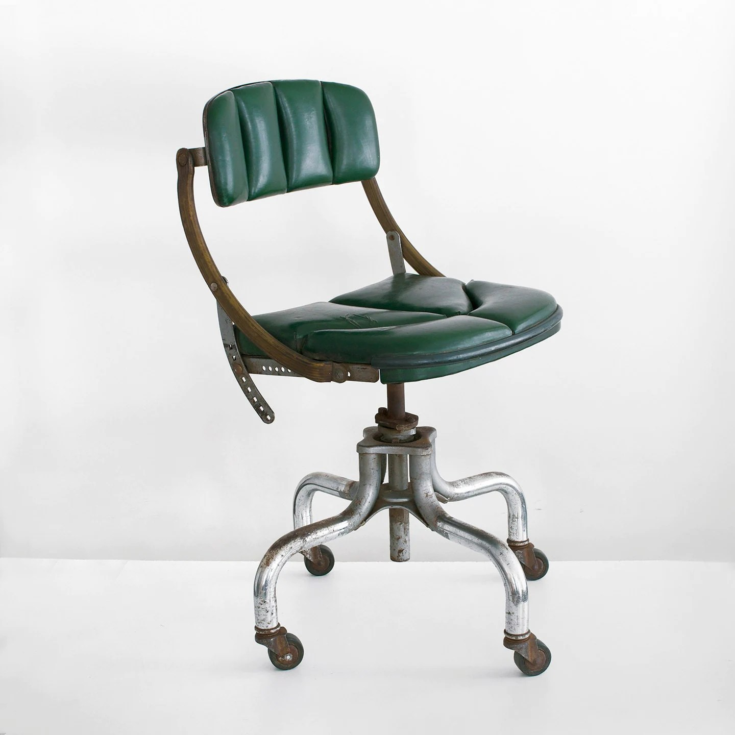 swivel chair nigeria toddler folding table and chairs vintage office do more industrial