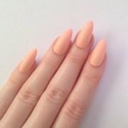 matte pastel peach stiletto nails