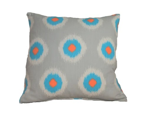 Pillow cover ikat dots in cotton/linen light gray background with aqua and orange accents