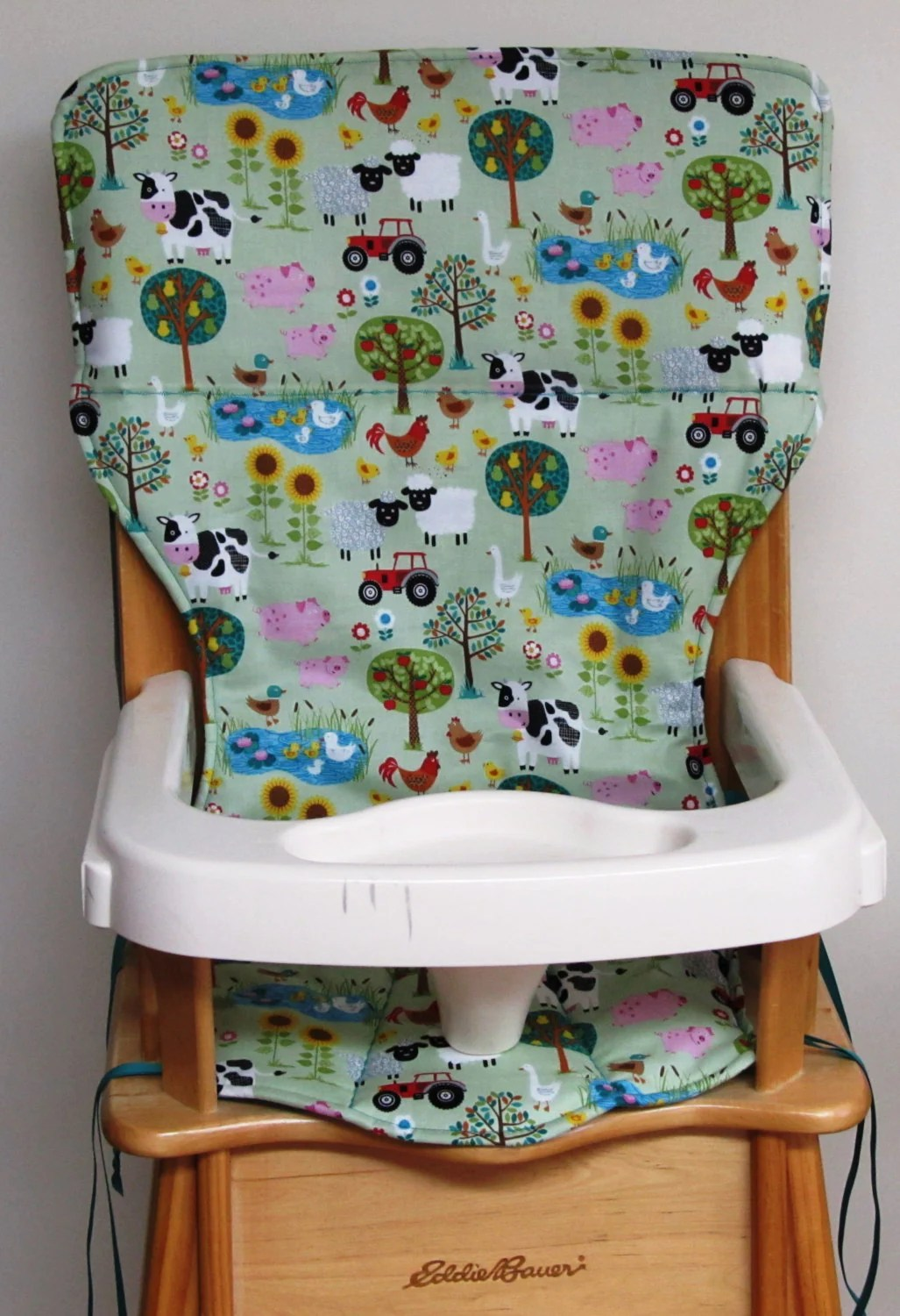 padded high chair swing olx pad eddie bauer wooden replacement