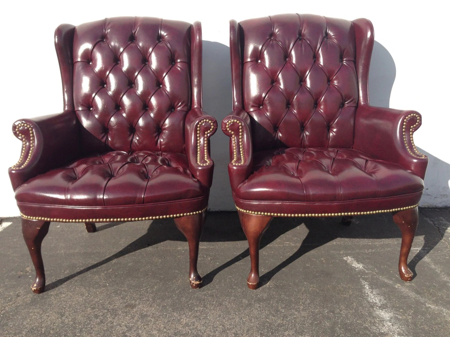 oxblood leather wing chair high back vinyl dining chairs 2 handsome deep tufted chippendale loungers