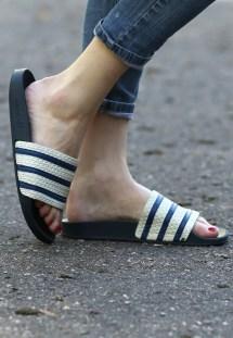 Woman Wearing Adidas Slides