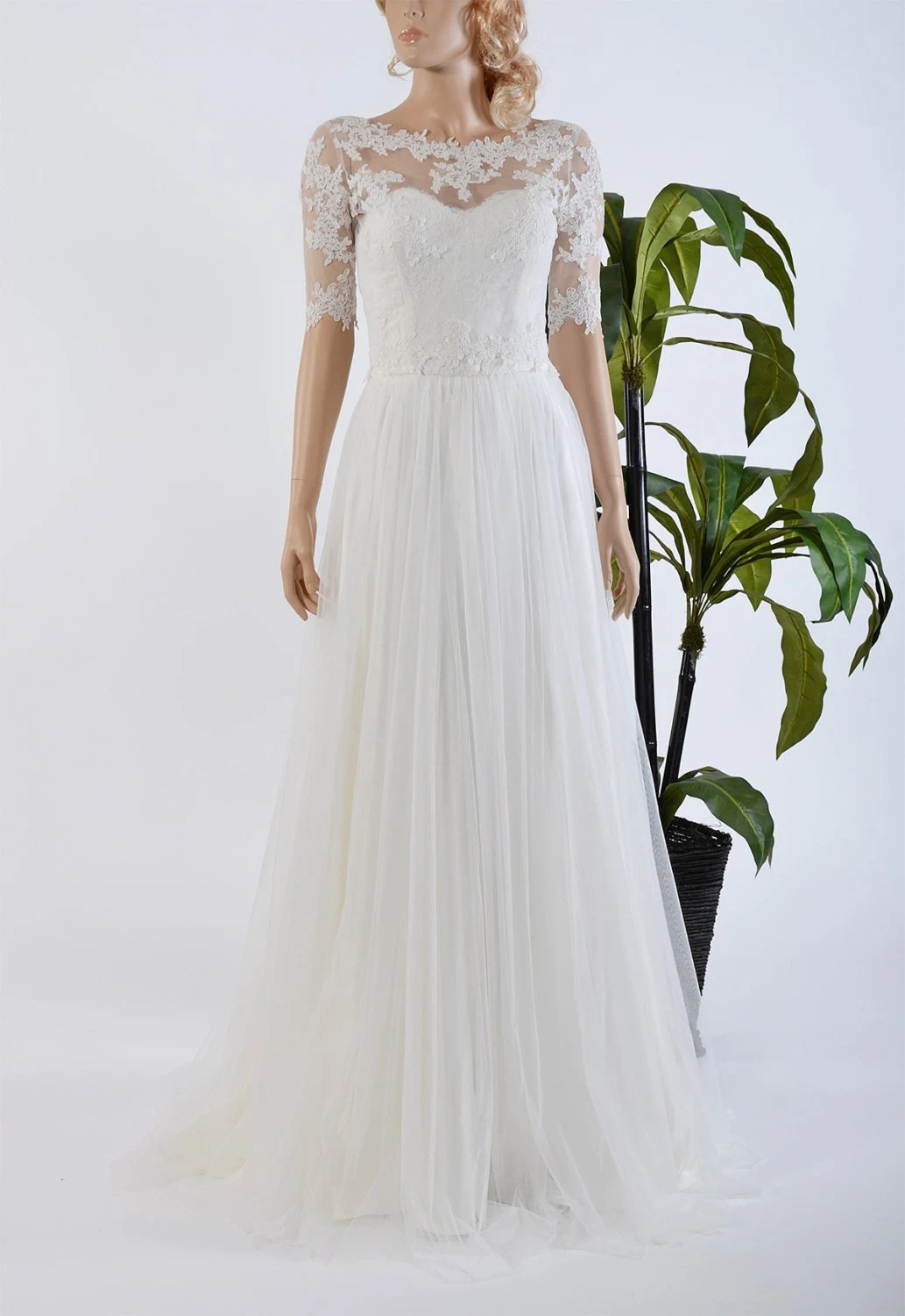Strapless lace wedding dress with boat neck elbow sleeve lace