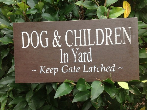 Dog And Children In Yard Gate Latched Sign