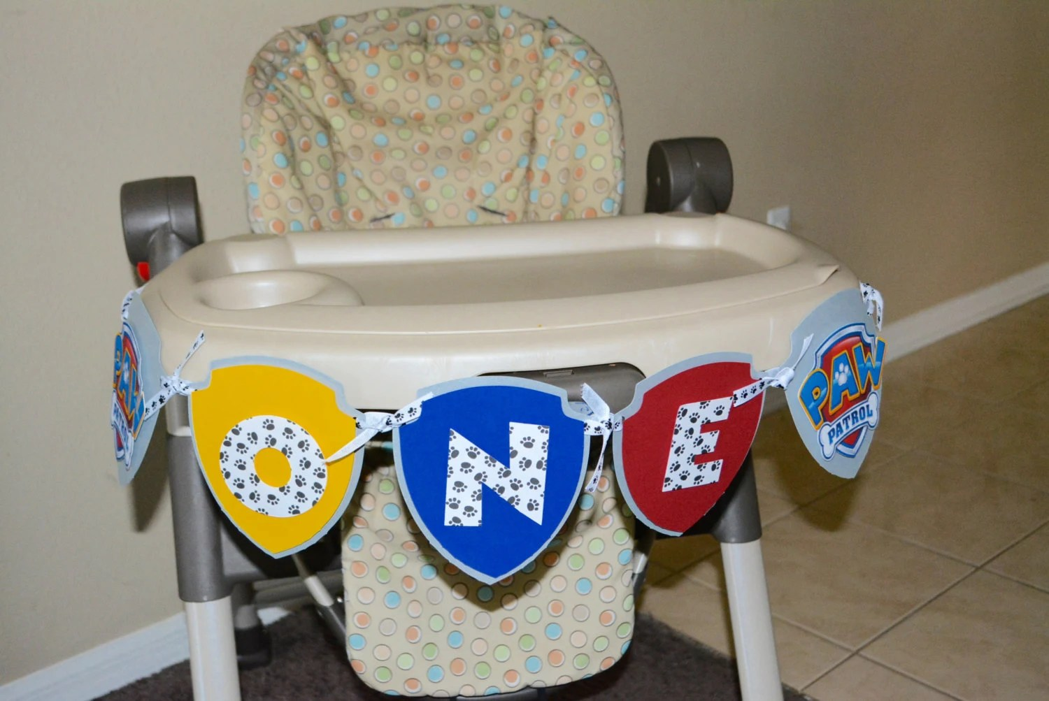high chair decorations 1st birthday boy pictures of chairs on the beach paw patrol one banner for