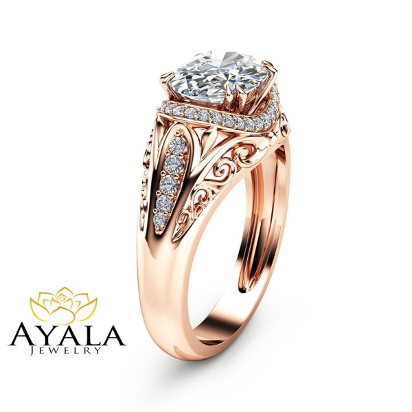 Unique Oval Moissanite Engagement Ring in 14K Rose Gold Halo