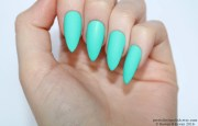 matte turquoise stiletto nails