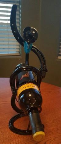 Items similar to Horseshoe Cowboy Wine Bottle Holder on Etsy