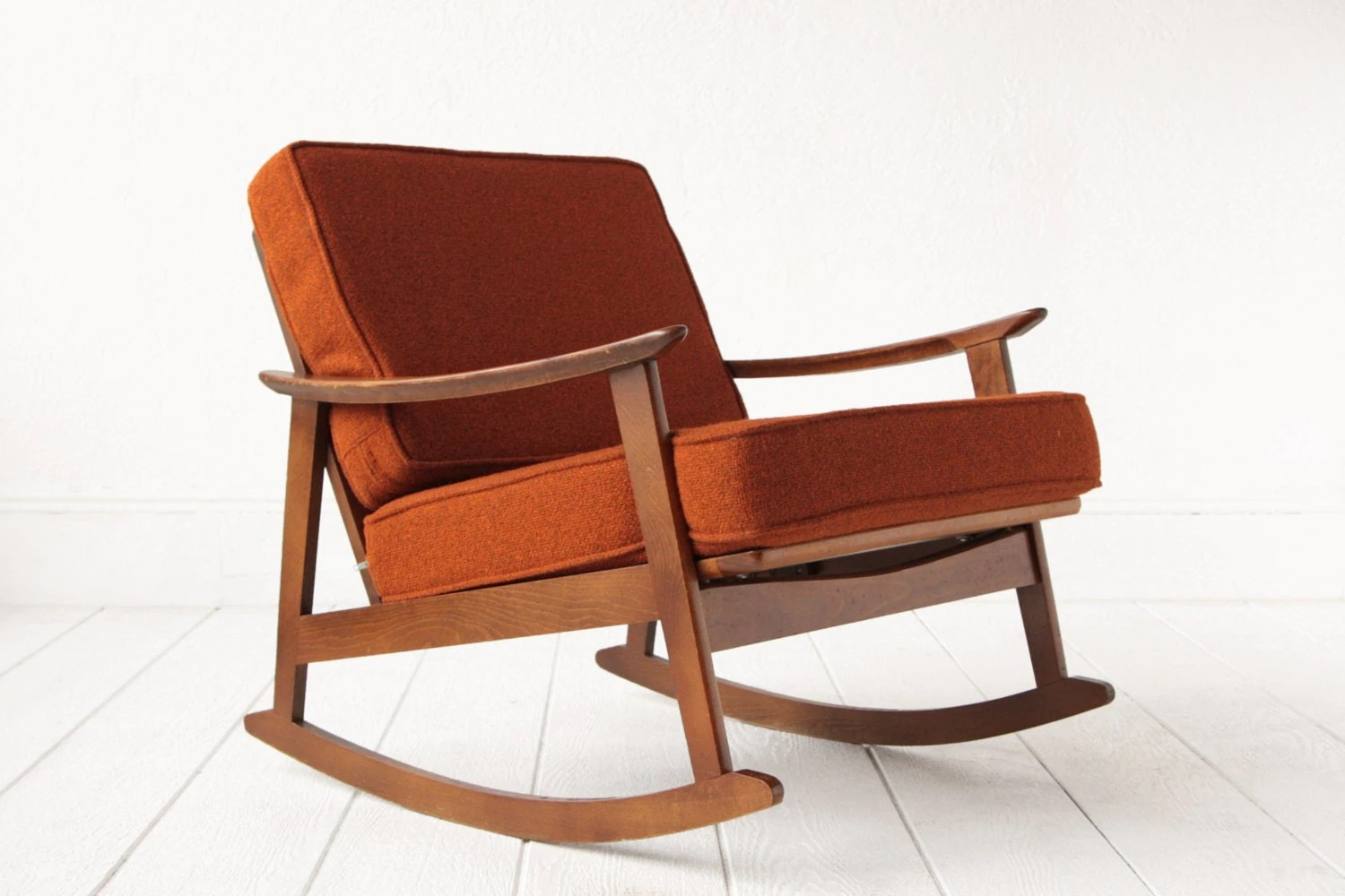 burnt orange rocking chair cushions posture in office mid century lounge
