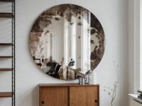 Antiqued round mirror. Decorative wall mirror that casts an