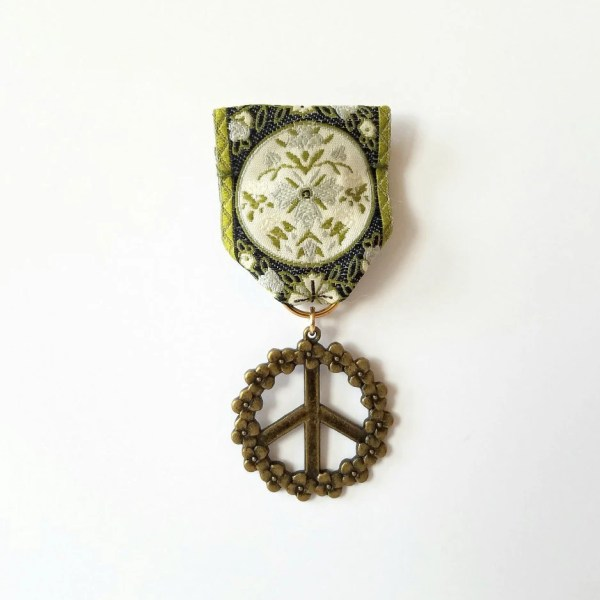 Moonflower Peace Medal Olive Cream Black Ribbon