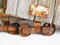 Two antique barn door rollers Frantz wheels w/ barn wood