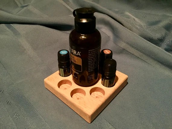 Massage Kit Oil Holder, White Oak Massage Kit Oil Holder, White Oak Massage Kit Oil Holder, White Oak 🔎zoom  Request a custom order and have something made just for you. Item details 5 out of 5 stars.      (1) reviews Shipping & Policies Do you have your favorite massage oils in 5ml bottles? This holder was designed specifically for dōTERRA's AromaTouch Technique Kit, including space for fractionated coconut oil. Keep your massage tools at the ready to offer the healing touch of massage and oils! Will hold any 5ml bottles or 4oz bottle in the center. This holder is made of white oak. Meet the owners of BalanceShared Learn more about their shop and process  Michelle Lasley    Peter Lasley Massage Kit Oil Holder, White Oak