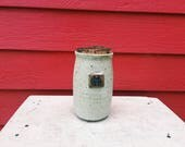 White Corked Jar with Cob...