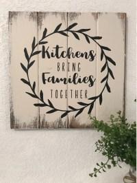 Kitchens bring families together Sign