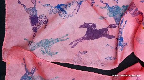 Pink Silk scarf with purple & blue galloping horses. Original horse print hand carved on linoleum block by artist,wearable equine art