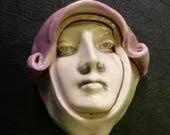 Handmade ceramic face lad...