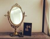 Vintage brass mirror, orn...