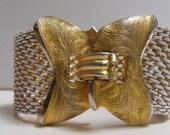 Signed Trifari wide mesh bracelet, white enameled mesh bracelet, large clasp